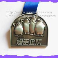 Buy cheap 3D engraved penguin medals, OEM zinc alloy 3D metal medal with ribbon China product